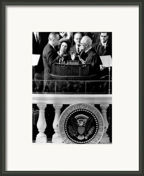 President Johnson Takes The Oath Framed Print By Everett