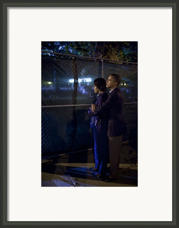 President Obama Embraces Michelle Framed Print By Everett