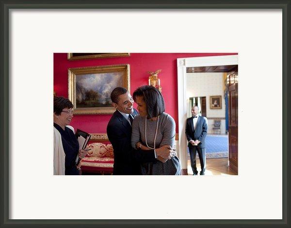 President Obama Hugs First Lady Framed Print By Everett
