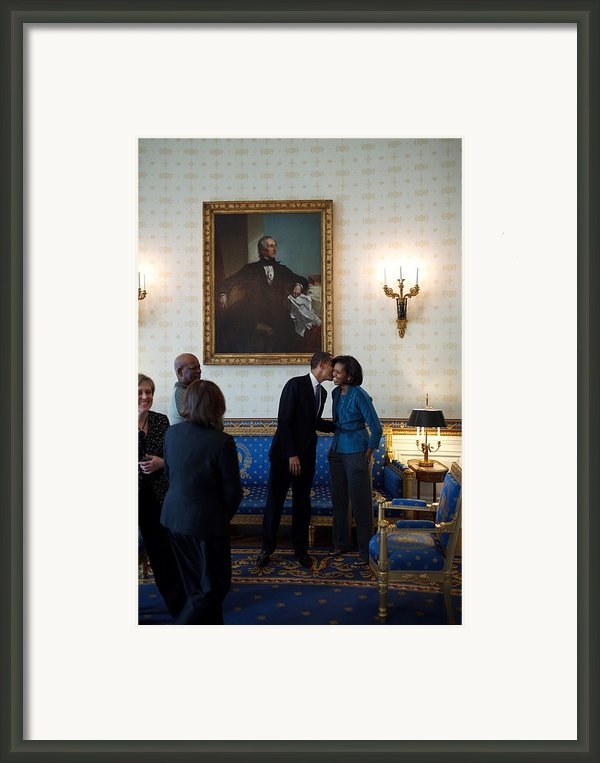President Obama Kisses First Lady Framed Print By Everett