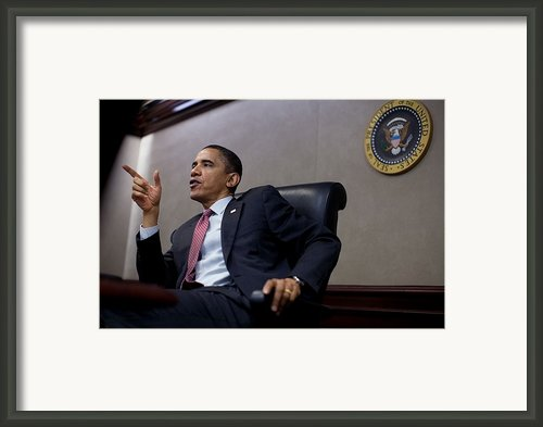 President Obama Speaks During A Meeting Framed Print By Everett