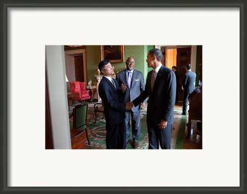 President Obama Talks With Commerce Framed Print By Everett