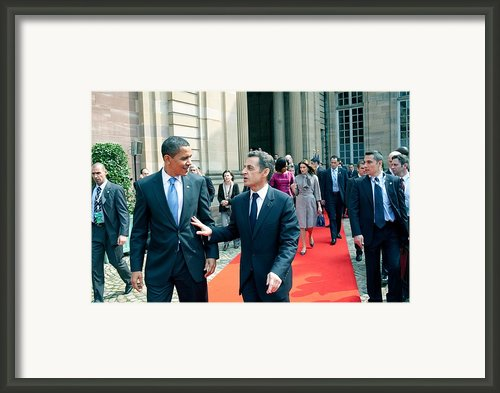 President Obama Walks With French Framed Print By Everett