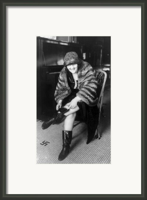 Prohibition, A Woman Putting A Flask Framed Print By Everett