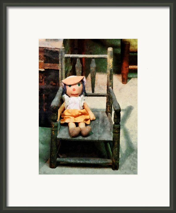Rag Doll In Chair Framed Print By Susan Savad
