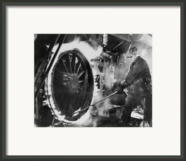 Railroad Worker Sweating A Tire Framed Print By Everett