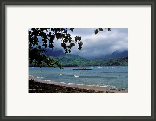 Red Canoe On Hanalei Bay Framed Print By Kathy Yates