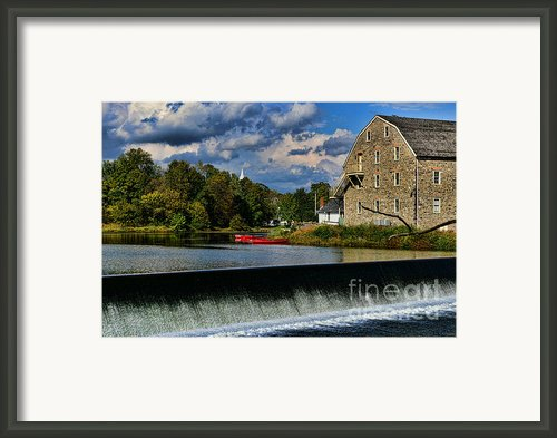 Red Canoes At The Boathouse Framed Print By Paul Ward