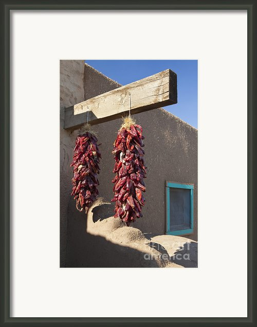 Red Chili Peppers Hanging Outdoors Framed Print By Bryan Mullennix