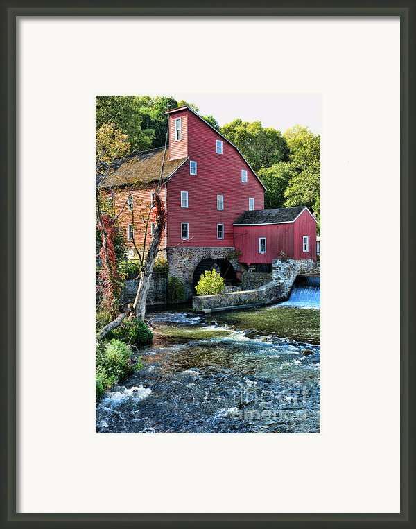 Red Mill On The Water Framed Print By Paul Ward