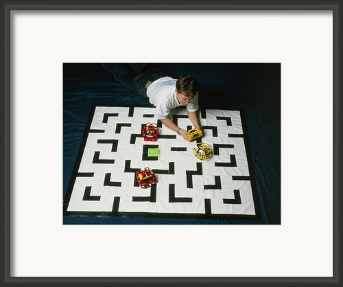 Researcher Testing Lego Robots Playing Pacman Framed Print By Volker Steger