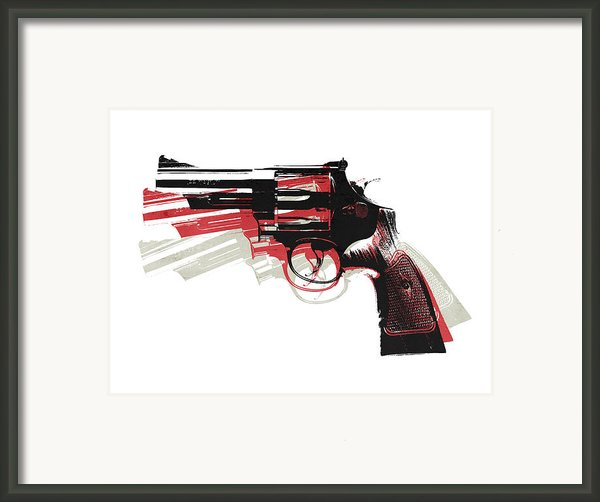 Revolver On White Framed Print By Michael Tompsett