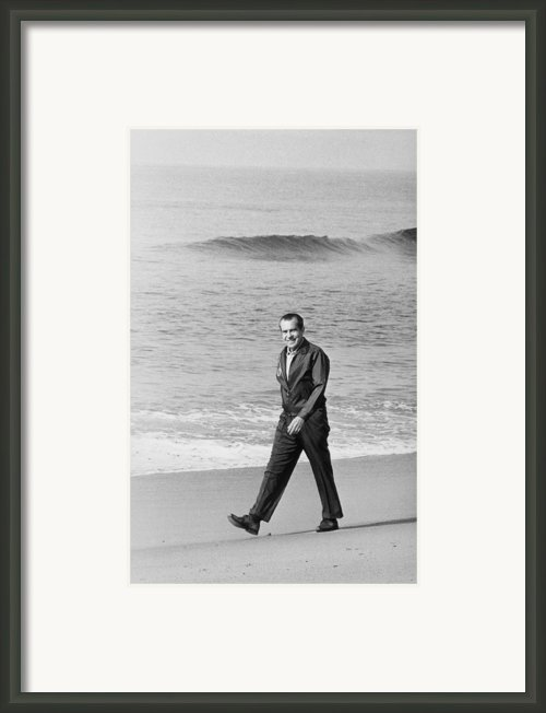 Richard Nixon Walking On The Beach Framed Print By Everett