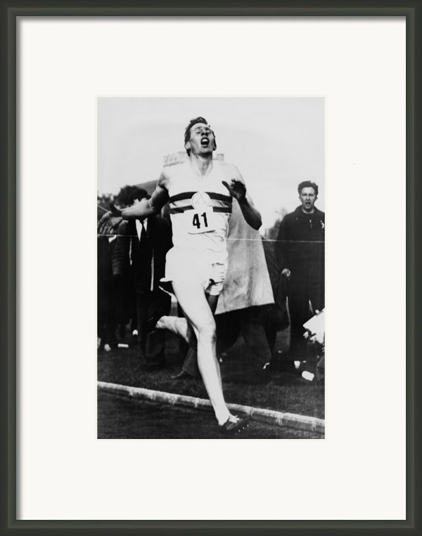 Roger Bannister Crossing The Finish Framed Print By Everett