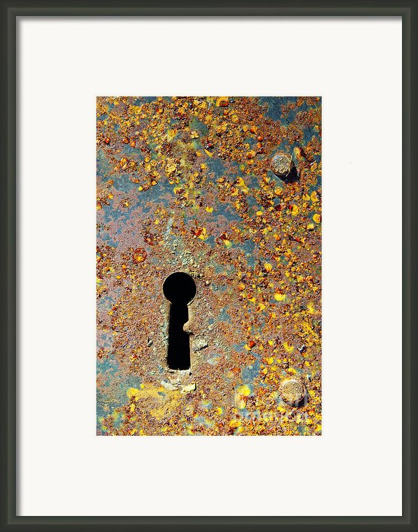 Rusty Key-hole Framed Print By Carlos Caetano