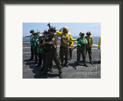 Sailors Fight A Simulated Fire Drill Framed Print By Stocktrek Images