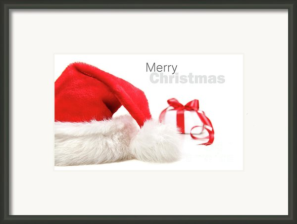 Santa Hat And Gift With Red Bow Framed Print By Sandra Cunningham