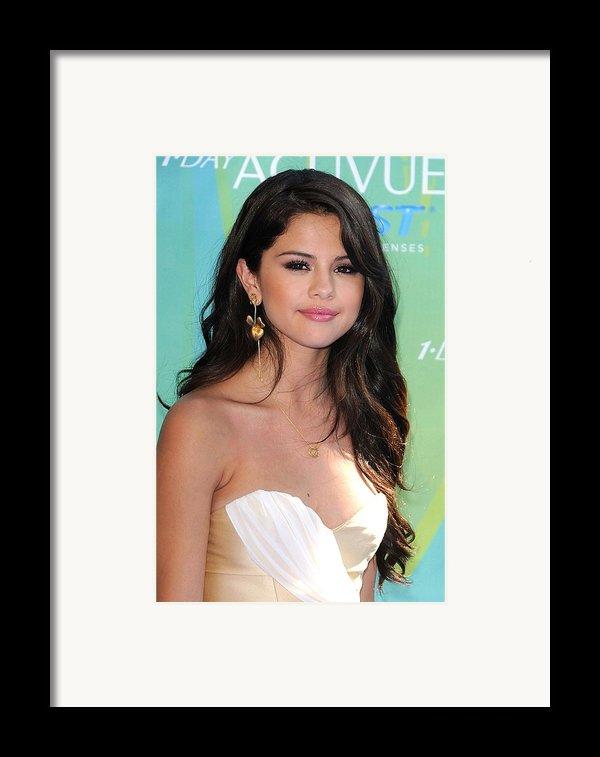 Selena Gomez At Arrivals For 2011 Teen Framed Print By Everett