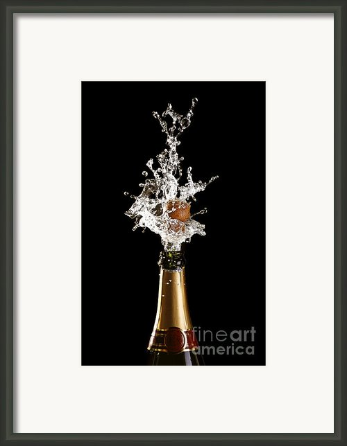 Shotting Cork Champagne Bottle Framed Print By Gualtiero Boffi