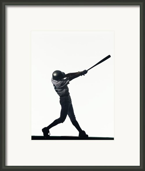 Silhouette Of Baseball Batter Swinging Bat, Side View Framed Print By Pm Images