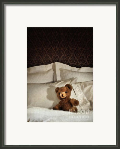 Small Teddy Bear On Bed Framed Print By Sandra Cunningham