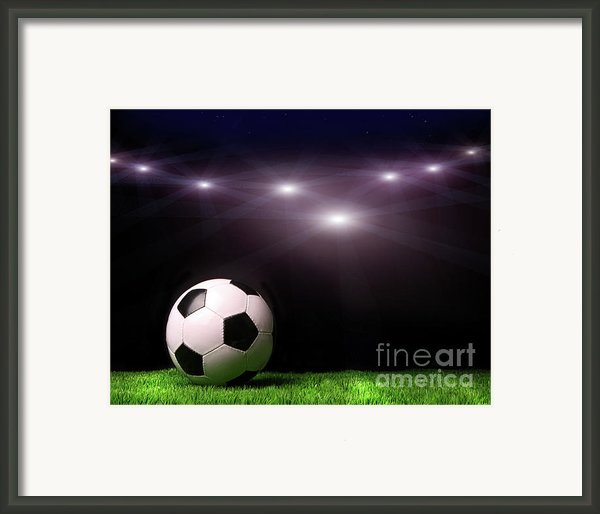 Soccer Ball On Grass Against Black Framed Print By Sandra Cunningham