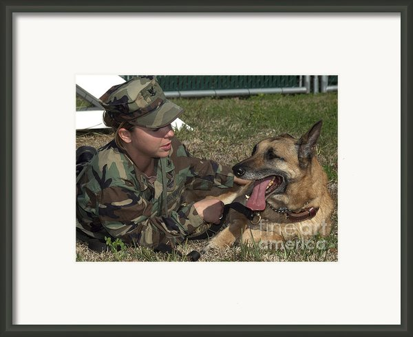 Soldier Gives Positive Reinforcement Framed Print By Stocktrek Images