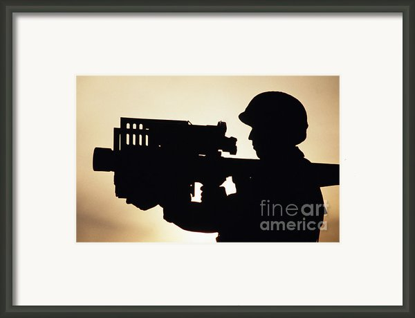 Soldier Holds A Stinger Anti-aircraft Framed Print By Stocktrek Images