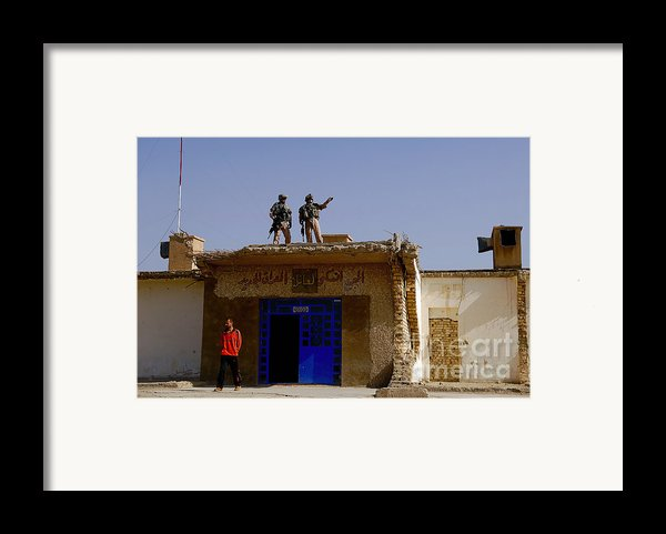 Soldiers Discuss The New Iraqi Police Framed Print By Stocktrek Images