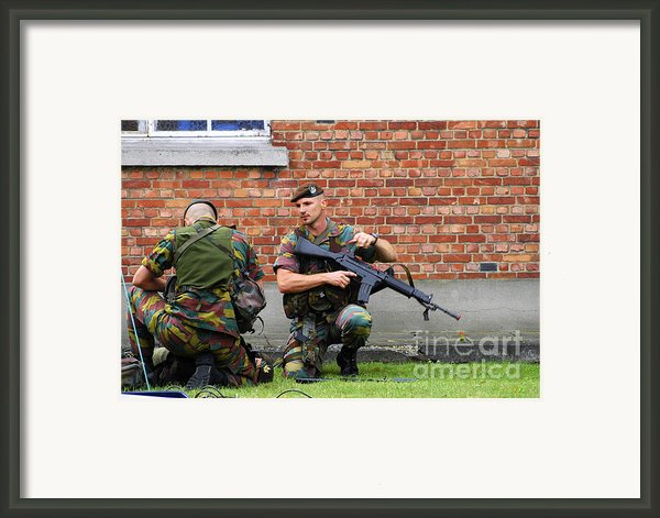 Soldiers Of The Belgian Army Helping Framed Print By Luc De Jaeger