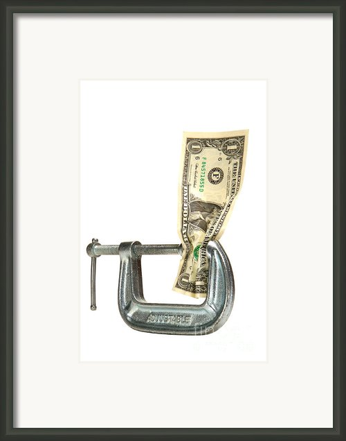 Squeezing The Dollar Framed Print By Olivier Le Queinec