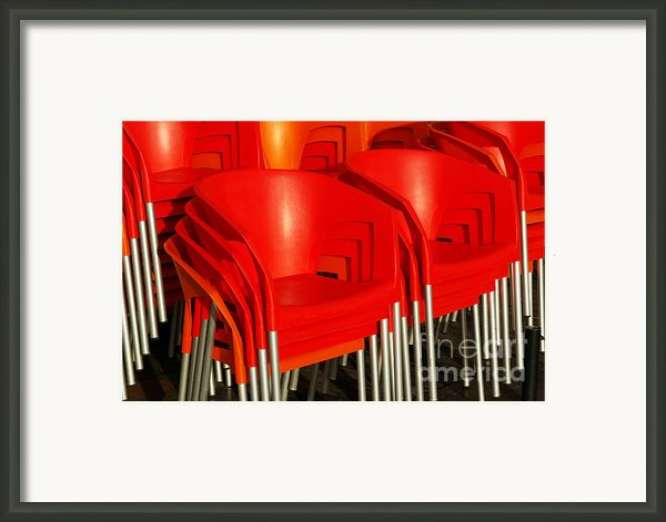 Stacked Chairs Framed Print By Carlos Caetano