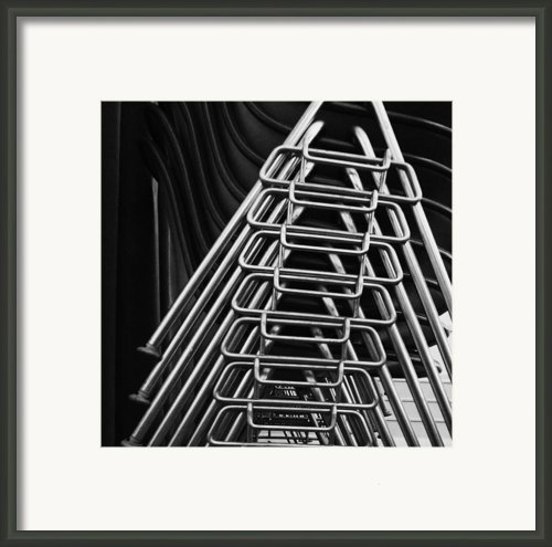Stacks Of Chairs Framed Print By Anna Villarreal Garbis