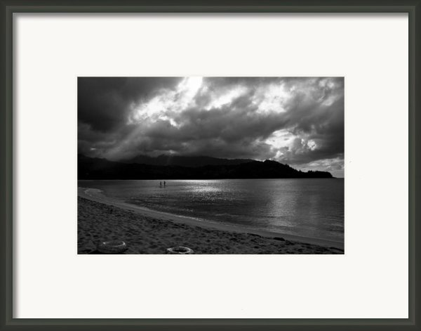 Stand Up Paddlers In Stormy Skies Framed Print By Lennie Green