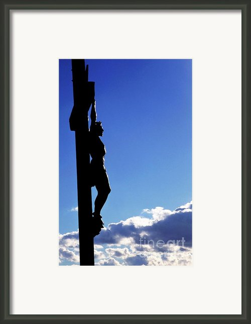 Statue Of Jesus Christ On The Cross Against A Cloudy Sky Framed Print By Sami Sarkis