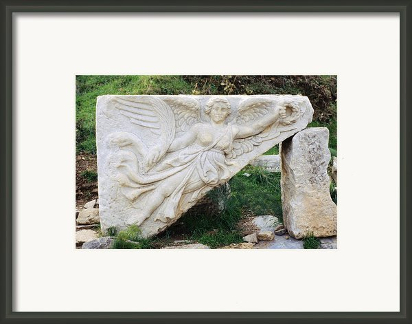 Stone Carving Of Nike Framed Print By Mark Greenberg