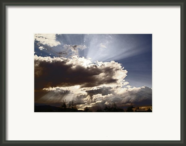 Sunlight And Stormy Skies Framed Print By Mick Anderson