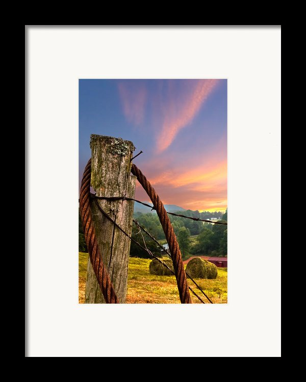 Sunrise Lasso Framed Print By Debra And Dave Vanderlaan