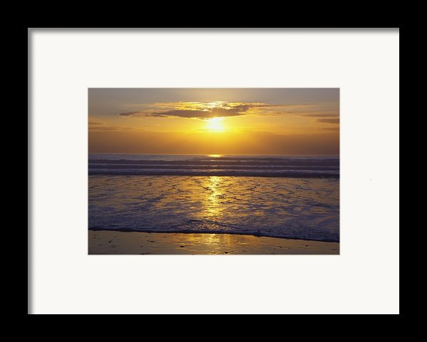 Sunset Over The Pacific Ocean Along The Framed Print By Craig Tuttle