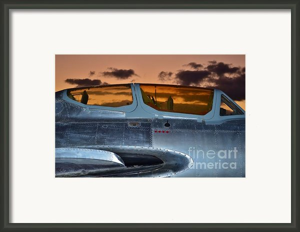 Sunset Through The Cockpit Framed Print By Lynda Dawson-youngclaus