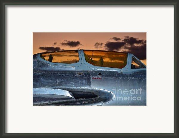 Sunset Through The Cockpit Framed Print By Lynda Dawson-youngclaus