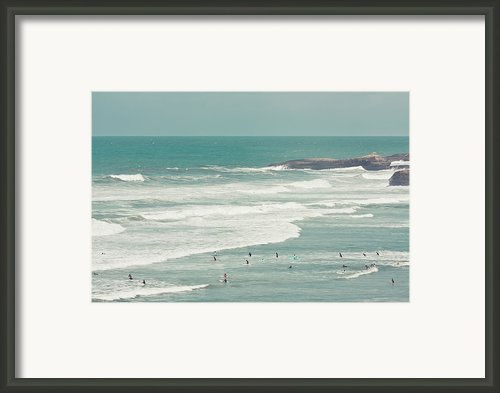 Surfers Lying In Ocean Framed Print By Cindy Prins