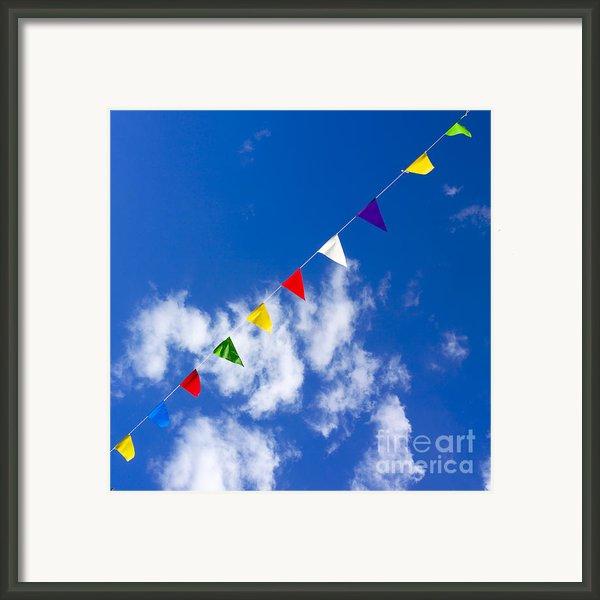 Suspended Festive Flags. Framed Print By Bernard Jaubert