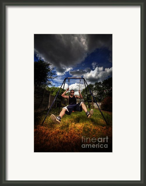 Swinger Framed Print By Yhun Suarez