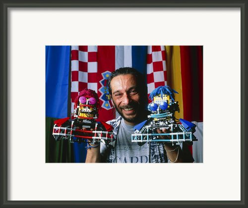 Technician With Lego Footballers At Robocup-98 Framed Print By Volker Steger