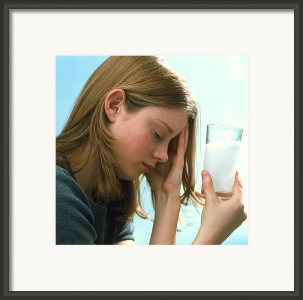 Teenager With Headache Holds Dissolving Painkiller Framed Print By Damien Lovegrove