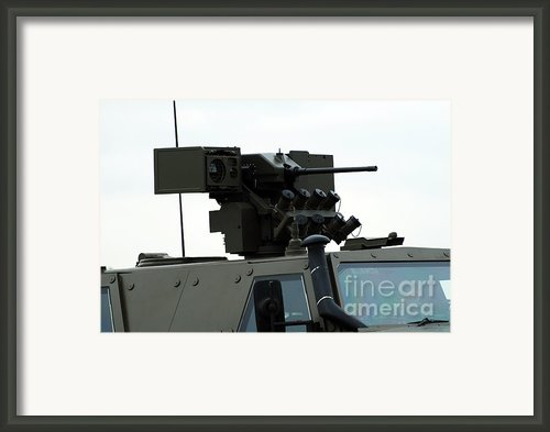 The Gun Mounted On Top Of The Dingo Ii Framed Print By Luc De Jaeger