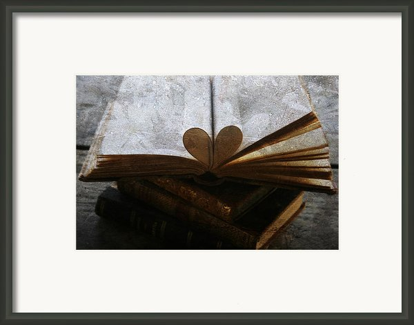The Love Of A Book Framed Print By Georgia Fowler