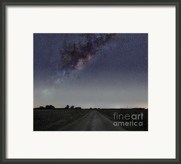 The Milky Way Galaxy Over A Rural Road Framed Print By Luis Argerich