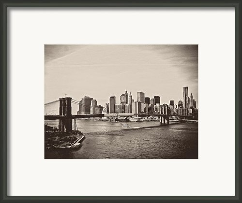 The New York City Skyline And The Brooklyn Bridge Framed Print By Vivienne Gucwa